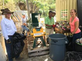 IGLA board members, from left, Vice President Doug White, Gary Ray and President Harith Wickrema, are assisted by volunteers Alice Krall and Carlito Delos Santo in recycling aluminum cans.